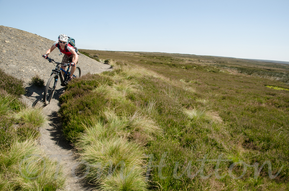 Enjoying some great singletrack on the line of a disused mining railway.